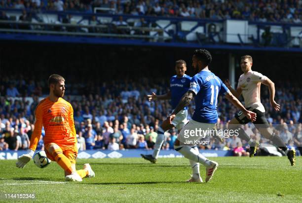 Theo Walcott of Everton scores his team's fourth goal past David De Gea of Manchester United during the Premier League match between Everton FC and...