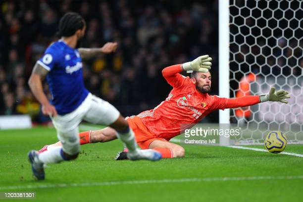 Theo Walcott of Everton scores his team's third goal past Ben Foster of Watford during the Premier League match between Watford FC and Everton FC at...
