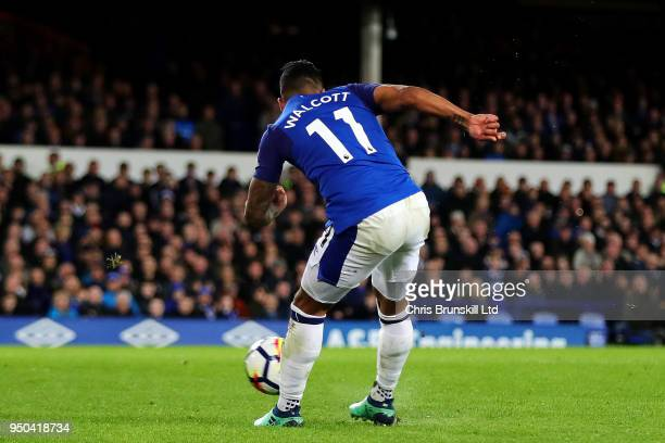 Theo Walcott of Everton scores the opening goal during the Premier League match between Everton and Newcastle United at Goodison Park on April 23...
