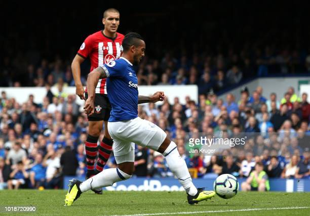 Theo Walcott of Everton shoots and scores his team's first goal during the Premier League match between Everton FC and Southampton FC at Goodison...