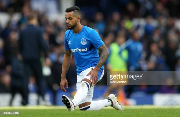 Theo Walcott of Everton warms up prior to the Premier League match between Everton and Brighton and Hove Albion at Goodison Park on March 10 2018 in...
