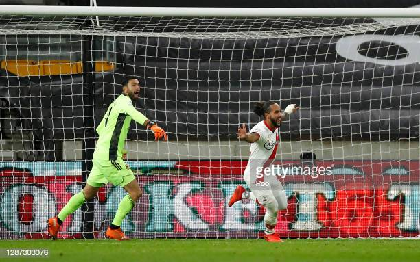 Theo Walcott of Southampton celebrates after scoring their team's first goal as Rui Patricio of Wolverhampton Wanderers reacts during the Premier...