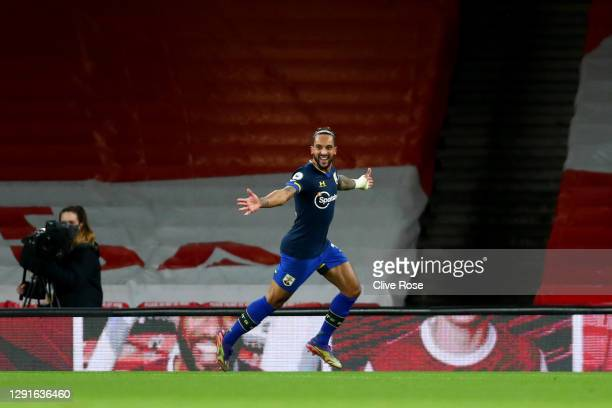 Theo Walcott of Southampton celebrates after scoring their team's first goal during the Premier League match between Arsenal and Southampton at...