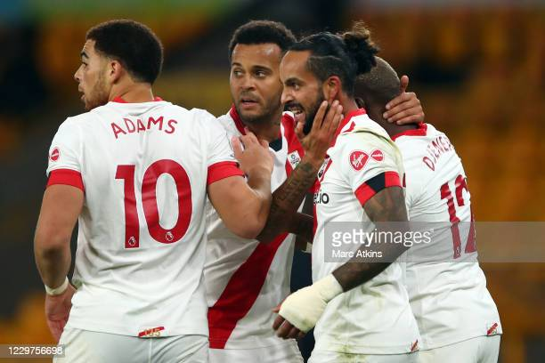 Theo Walcott of Southampton celebrates his goal with team mates during the Premier League match between Wolverhampton Wanderers and Southampton at...
