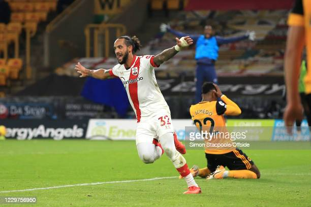 Theo Walcott of Southampton celebrates scoring the opening goal during the Premier League match between Wolverhampton Wanderers and Southampton at...