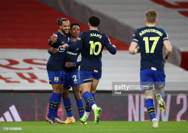 Theo Walcott of Southampton celebrates with Kyle Walker-Peters and Che Adams after scoring their team's first goal during the Premier League match...