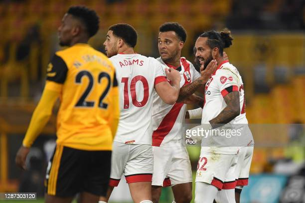 Theo Walcott of Southampton celebrates with Ryan Bertrand, Moussa Djenepo and Che Adams after scoring their team's first goal during the Premier...