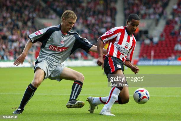 Theo Walcott of Southampton holds off Andy Wilkinson of Stoke City during the CocaCola Championship match between Southampton and Stoke City at St...