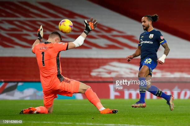 Theo Walcott of Southampton scores their team's first goal past Bernd Leno of Arsenal during the Premier League match between Arsenal and Southampton...