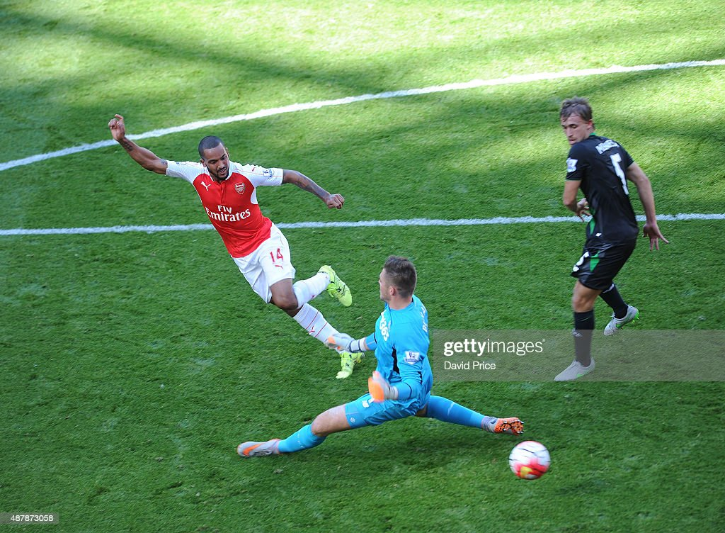 Theo Walcott scores a goal for Arsenal past Jack Butland of Stoke during the Barclays Premier League match between Arsenal and Stoke City on September 12, 2015 in London, United Kingdom.