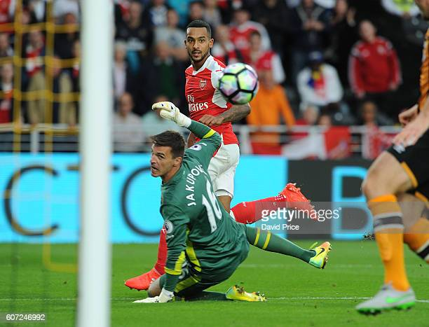 Theo Walcott scores Arsenal's 2nd goal past Eldin Jakupovic of Hull during the Premier League match between Hull City and Arsenal at KCOM Stadium on...