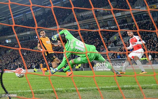 Theo Walcott scores Arsenal's 3rd goal past Eldin Jakupovic of Hull during the match between Hull City and Arsenal in the FA Cup 5th round at KC...