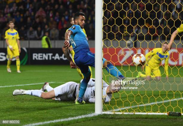 Theo Walcott shoots past BATE goalkeeper Denis Scherbitski to score for Arsenal during the UEFA Europa League group H match between BATE Borisov and...