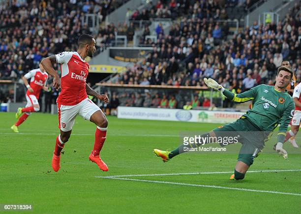 Theo Walcott shoots past Hull goalkeeper Eldin Jakupovic to score the 2nd Arsenal goal during the Premier League match between Hull City and Arsenal...
