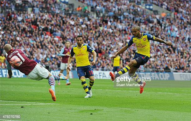 Theo Walcott shoots pastAston Villa defender Alan Hutton to score for Arsenal during the FA Cup Final between Aston Villa and Arsenal at Wembley...
