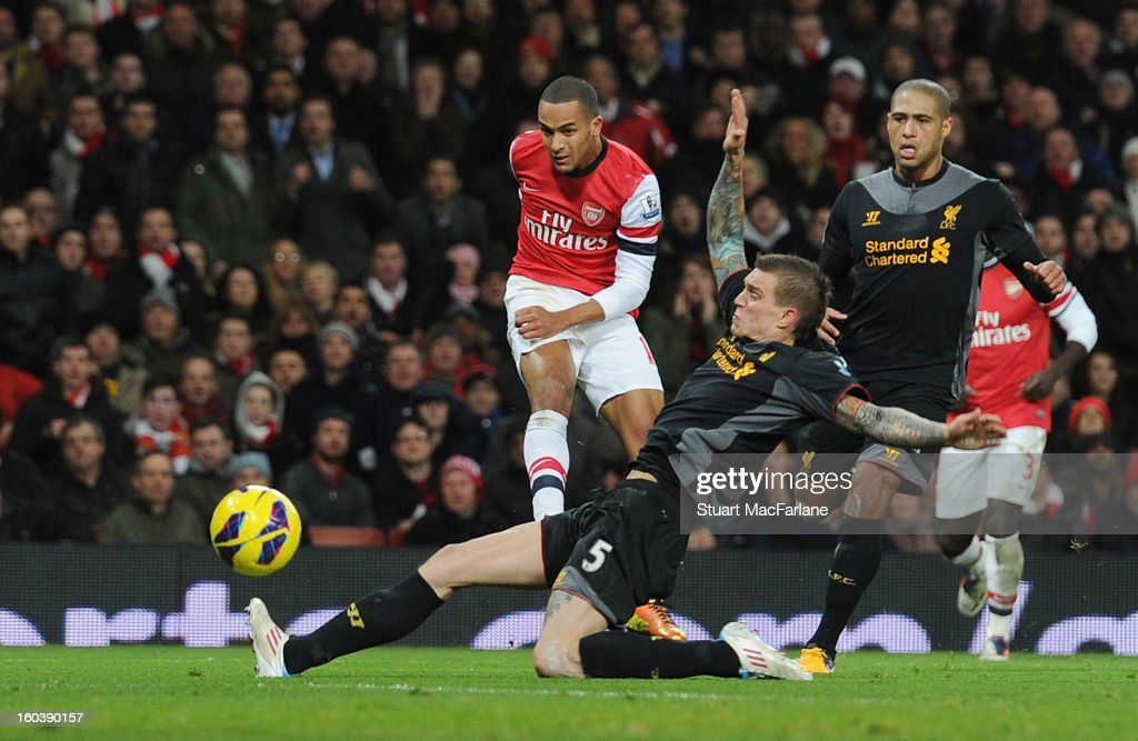 Theo Walcott shoots to score the 2nd Arsenal goal during the Barclays Premier League match between Arsenal and Liverpool at Emirates Stadium on January 30, 2013 in London, England.