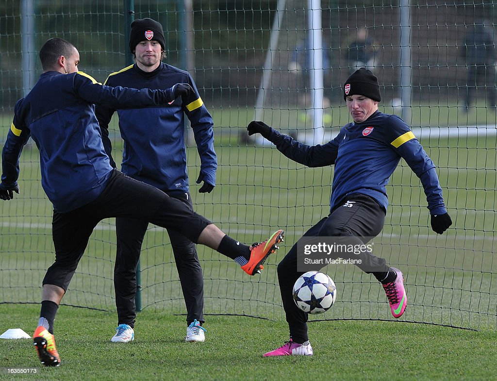 Theo Walcott; Tomas Rosicky and Andrey Arshavin of Arsenal during a training session at London Colney on March 12, 2013 in St Albans, England.