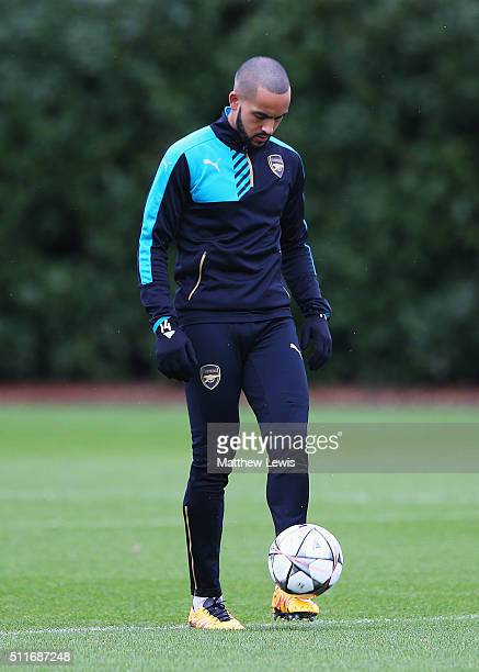 Theo Walcott warms up during an Arsenal training session ahead of the UEFA Champions League match against Barcelona at London Colney on February 22...