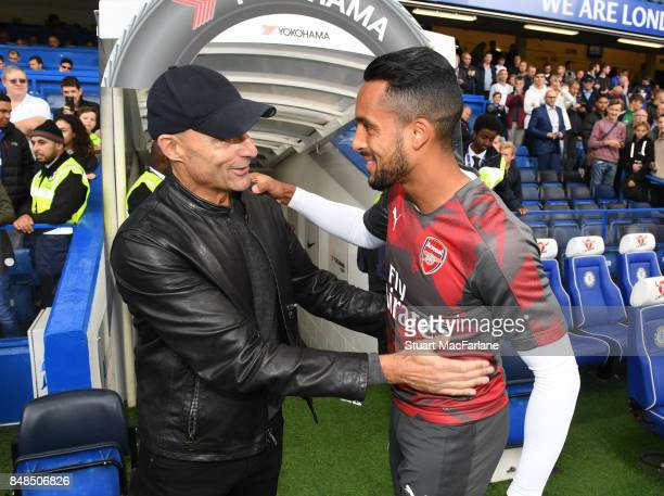 Theo Walcott with Arsenal fan and actor Mark Strong before the Premier League match between Chelsea and Arsenal at Stamford Bridge on September 17...