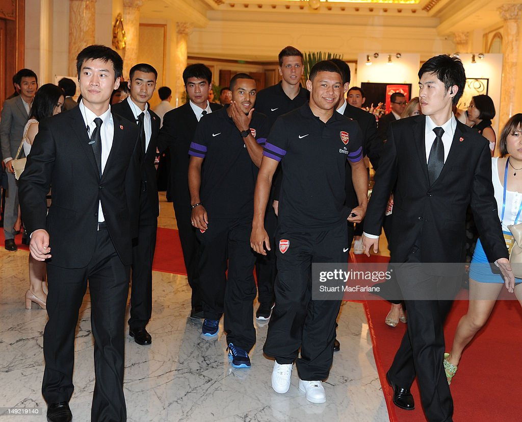 Theo Walcott (4th L), Wojciech Szczesny (C) and Alex Oxlade-Chamberlain (2nd R) of Arsenal leave a charity dinner in Beijing during their pre-season Asian Tour in China on July 25 2012 in Beijing, China.