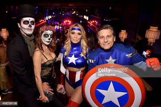 Theo Wargo Melissa Stover Jennifer Mazur and Kevin Mazur attend Moto X presents Heidi Klum's 15th Annual Halloween Party sponsored by SVEDKA Vodka at...