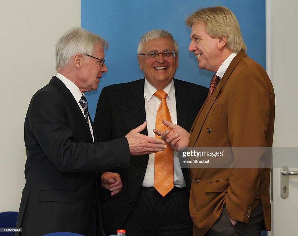 Theo Zwanziger (C), president of the German football association (DFB) and Reinhard Rauball (L), president of the German Football League (DFL) talk to Volker Bouffier, Interior Minister of the German state of Hesse prior to the round table discussion on the subject of 'Gewalt im Zusammenhang mit Fussballspielen' (Violence in football) during the interior minister conference in the ministry of internal affairs on April 23, 2010 in Berlin, Germany.