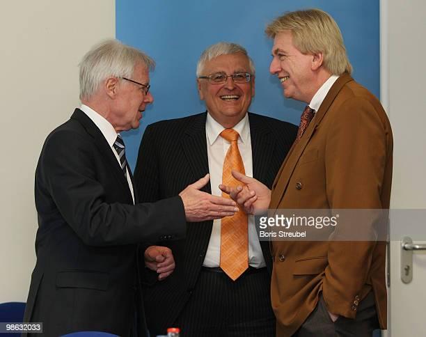 Theo Zwanziger , president of the German football association and Reinhard Rauball , president of the German Football League talk to Volker Bouffier,...