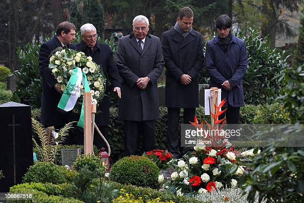 Theo Zwanziger, president of the German Football Association , lays down a wreath next to Karl Rothmund, vice president of the German Football...
