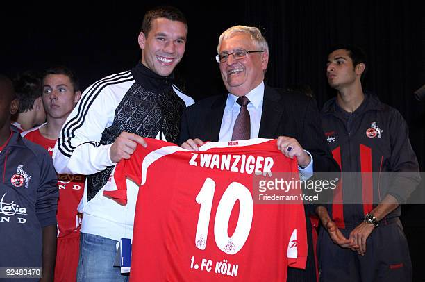 Theo Zwanziger president of the German Football Association receives a football shirt from Lukas Podolski during the elite sports school of football...