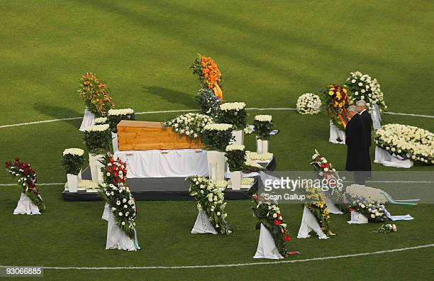 Theo Zwanziger president of the German Football Federation pays his last respects at the coffin of Hannover 96 goalkeeper Robert Enke at a memorial...