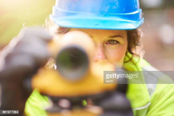 theodolite worker - survey stock photos and pictures