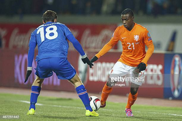 Theodor Elmar Bjarnason of Iceland Quincy Promes of Holland during the EURO 2016 qualifying match between Iceland and Netherlands on October 13 2014...