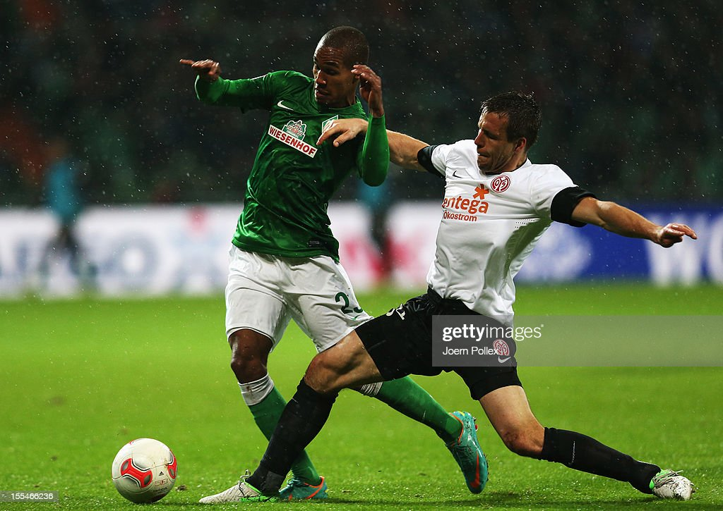 Theodor Gebre Selassie (L) of Bremen and Nikolce Noveski of Mainz compete for the ball during the Bundesliga match between SV Werder Bremen and 1. FSV Mainz 05 at Weser Stadium on November 4, 2012 in Bremen, Germany.