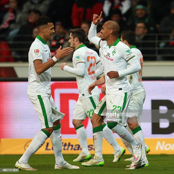 Theodor Gebre Selassie of Bremen celebrates his team's first goal with team mate Davie Selke during the Bundesliga match between Eintracht Frankfurt...