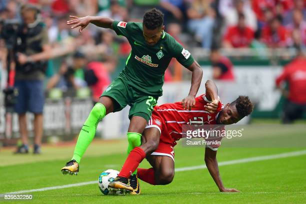 Theodor Gebre Selassie of Bremen fights for the ball with Kingsley Coman of Bayern Muenchen during the Bundesliga match between SV Werder Bremen and...