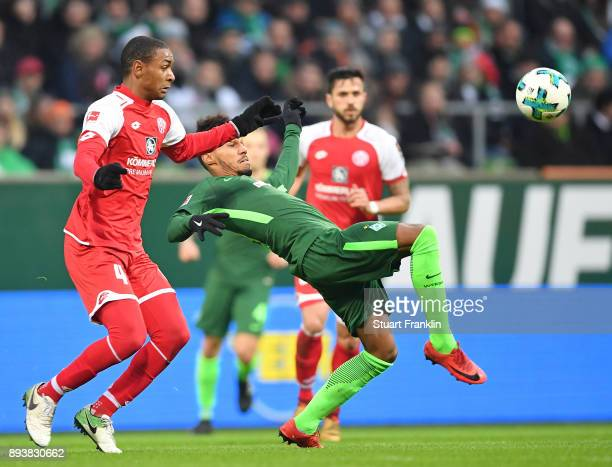 Theodor Gebre Selassie of Bremen is challenged by Abdou Diallo of Mainz during the Bundesliga match between SV Werder Bremen and 1 FSV Mainz 05 at...