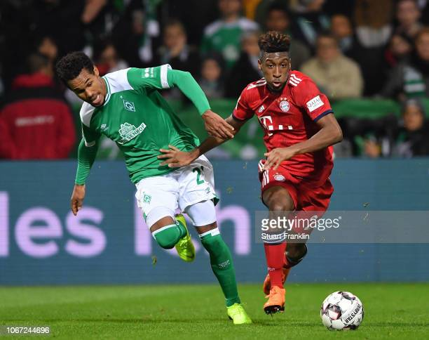 Theodor Gebre Selassie of Bremen is challenged by Kingsley Coman of Muenchen during the Bundesliga match between SV Werder Bremen and FC Bayern...