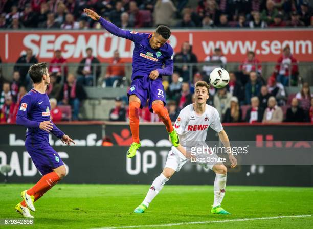 Theodor Gebre Selassie of Bremen scores his teams second goal against Lukas Kluenter of Koeln during the Bundesliga match between 1 FC Koeln and...