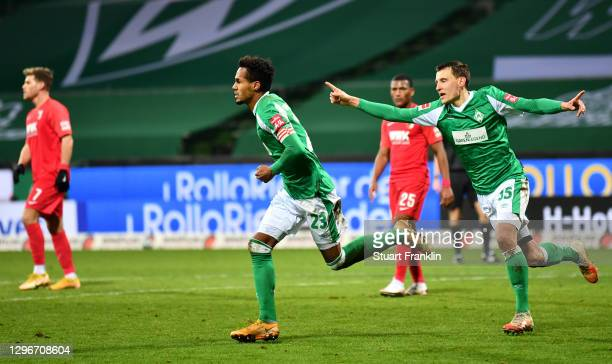 Theodor Gebre Selassie of SV Werder Bremen celebrates after scoring his team's first goal during the Bundesliga match between SV Werder Bremen and FC...