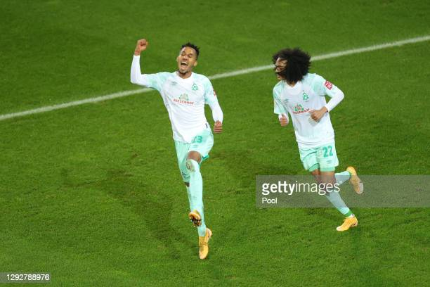 Theodor Gebre Selassie of SV Werder Bremen celebrates with team mate Tahith Chong after scoring their sides first goal during the DFB Cup second...