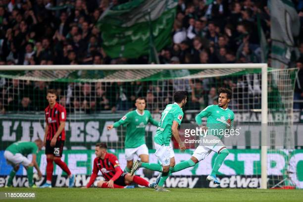 Theodor Gebre Selassie of SV Werder Bremen celebrates with teammate Nuri Sahin after scoring his team's second goal during the Bundesliga match...