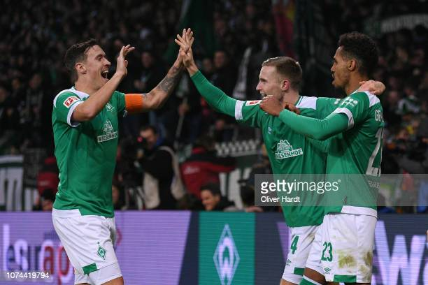 Theodor Gebre Selassie of SV Werder Bremen celebrates with teammates after scoring his team's first goal during the Bundesliga match between SV...