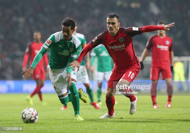 Theodor Gebre Selassie of Werder Bremen and Filip Kostic of Eintracht Frankfurt battle for the ball during the Bundesliga match between SV Werder...