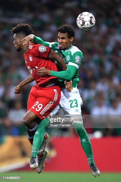 Theodor Gebre Selassie of Werder Bremen and Kingsley Coman of Bayern Munich battle for possession during the DFB Cup semi final match between Werder...