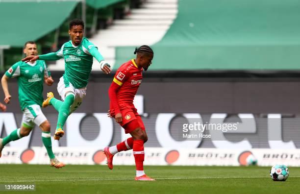 Theodor Gebre Selassie of Werder Bremen battles for possession with Leon Bailey of Bayer Leverkusen during the Bundesliga match between SV Werder...