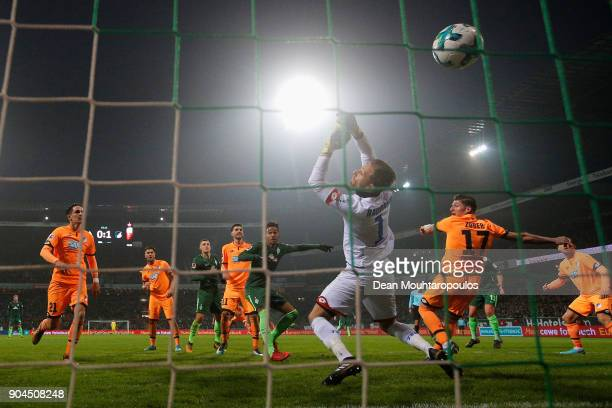 Theodor Gebre Selassie of Werder Bremen shoots and scores his teams first goal of the game past Goalkeeper, Oliver Baumann of TSG 1899 Hoffenheim...