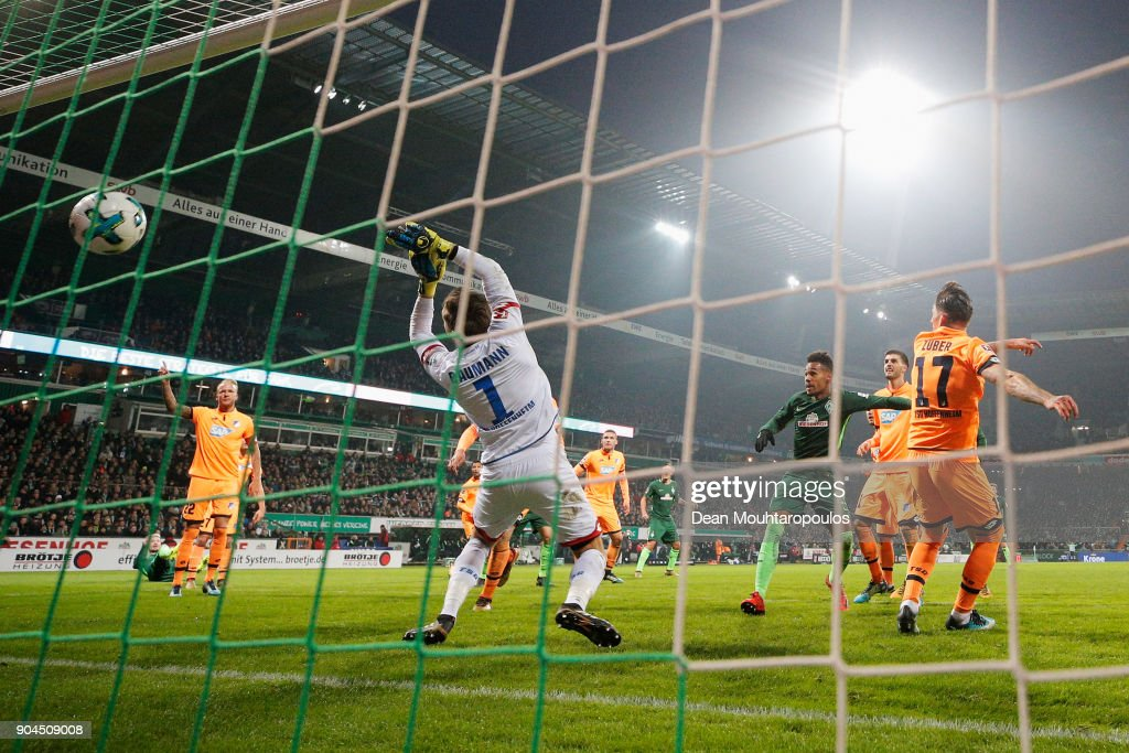 Theodor Gebre Selassie of Werder Bremen shoots and scores his teams first goal of the game past Goalkeeper, Oliver Baumann of TSG 1899 Hoffenheim during the Bundesliga match between SV Werder Bremen and TSG 1899 Hoffenheim at Weserstadion on January 13, 2018 in Bremen, Germany.