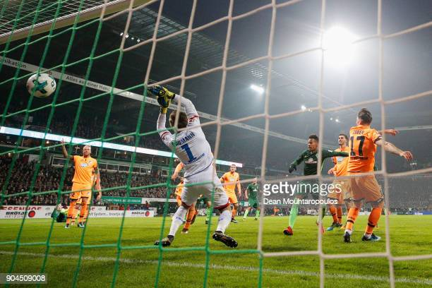 Theodor Gebre Selassie of Werder Bremen shoots and scores his teams first goal of the game past Goalkeeper Oliver Baumann of TSG 1899 Hoffenheim...
