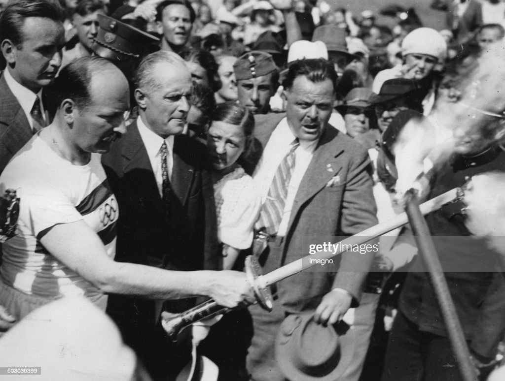 Theodor Schmidt - President Of The Austrian Olympic Committee At The The Torch Handover At The Border Of Hungary - Austria. 1936.Photograph. : News Photo