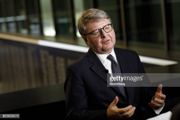 Theodor Weimer chief executive officer of Deutsche Boerse AG gestures while speaking during a Bloomberg Television interview following a news...